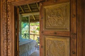 amor-boutique-hotel-de-amor-equisite-hand-carved-wood-door