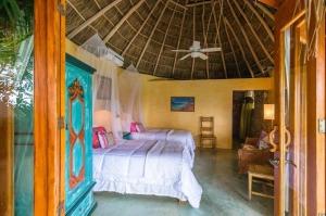 amor-boutique-hotel-las-palmas-palapa-roof-bedroom-sayulita-mexico