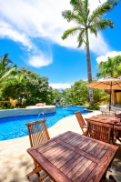 amor-boutique-hotel-in-sayulita-resort-pool-palm-chairs
