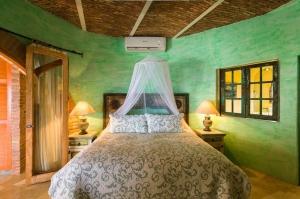 amor-boutique-hotel-las-palmas-master-bedroom-green-venetian-plaster