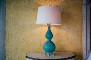 amor-boutique-hotel-villa-romance-blue-glass-lamp-yellow-wall