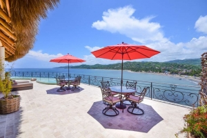 amor-boutique-hotel-villa-romance-ocean-view-terrace-umbrellas